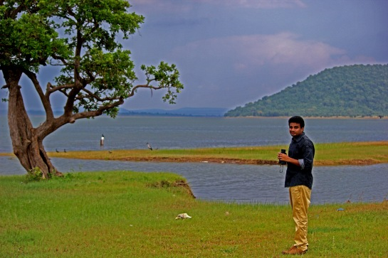 When I travel, I observe the beauty of the place.. That's me with the backdrop of Pakhal lake..
