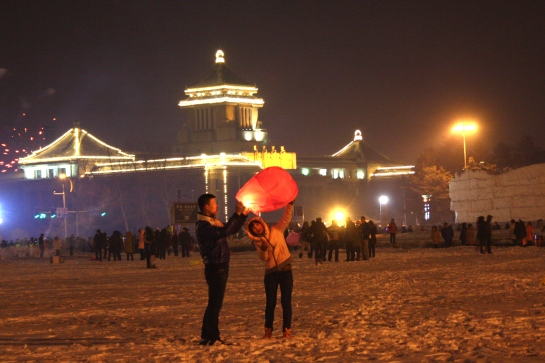 A young couple trying to fly their lantern at culture square,changchun