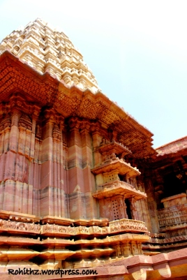 Notice the distinct looking walls which are well treated with broad and narrow pillars in Red sand stone..
