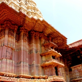 Notice the distinct looking walls which are well treated withbroad and narrow pillars in Red sand stone..