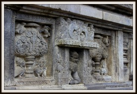 simha (lion) flanked by two panels depicting bountiful kalpataru (kalpavriksha) tree.