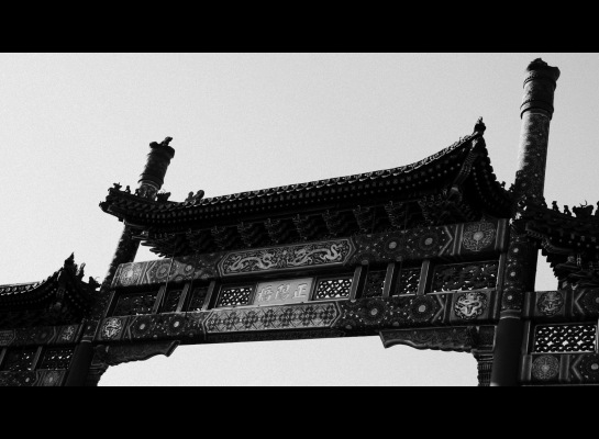 Paifang is a traditional Chinese architectural gating style as an arch. This have been derived from the torana temple-gate in ancient India, though it has taken on traditional Chinese architectural characteristics such as multi-tiered roofs, various supporting posts, and archway-shapes of traditional gates and towers. Source: Wikipedia
