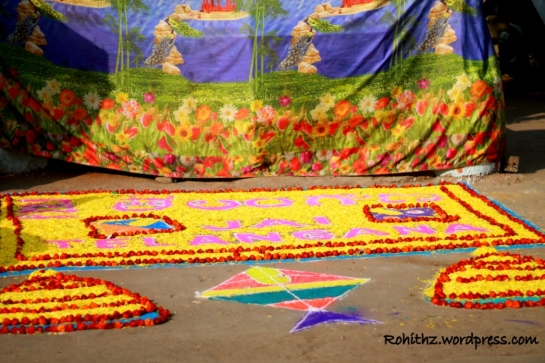 beautiful muggu  decorated  with flowers, colours and sparkle colours.