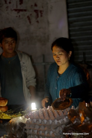 Charming Lady feeding the streets of Darjeeling..