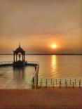 Sunset over Godavari river.. That's statue of Telugu talli