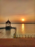 Sunset over Godavari river.. That's statue of Telugu talli